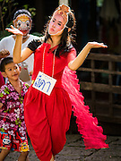 """29 SEPTEMBER 2016 - BANGKOK, THAILAND:  A supporter of the Pom Mahakan community participates in a """"khon"""" dance, a traditional Thai dance that tells the story of the Ramakien (Thai adaptation of the Ramayana). Forty-four families still live in the Pom Mahakan Fort community. The status of the remaining families is not clear. Bangkok officials are still trying to move them out of the fort and community leaders are barricading themselves in the fort. The residents of the historic fort are joined almost every day by community activists from around Bangkok who support their efforts to stay.    PHOTO BY JACK KURTZ"""
