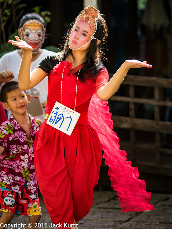 "29 SEPTEMBER 2016 - BANGKOK, THAILAND:  A supporter of the Pom Mahakan community participates in a ""khon"" dance, a traditional Thai dance that tells the story of the Ramakien (Thai adaptation of the Ramayana). Forty-four families still live in the Pom Mahakan Fort community. The status of the remaining families is not clear. Bangkok officials are still trying to move them out of the fort and community leaders are barricading themselves in the fort. The residents of the historic fort are joined almost every day by community activists from around Bangkok who support their efforts to stay.    PHOTO BY JACK KURTZ"