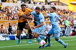 Adama Traore of Wolverhampton Wanderers takes on Erik Pieters of Burnley and Aaron Lennon of Burnley - Mandatory by-line: Robbie Stephenson/JMP - 25/08/2019 - FOOTBALL - Molineux - Wolverhampton, England - Wolverhampton Wanderers v Burnley - Premier League
