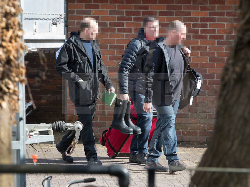 NOTE TO EDITORS - Please note that we have received a request that weapons inspectors faces be pixelated. © Licensed to London News Pictures. 21/03/2018. Salisbury, UK. Investigators from the Organisation for the Prohibition of Chemical Weapons (OPCW)  arrive at The Mill pub in Salisbury as police continue their investigation after former Russian spy Sergei Skripal and his daughter Yulia were poisoned with nerve agent. The couple where found unconscious on bench in Salisbury shopping centre. A policeman who went to their aid is currently recovering in hospital. Photo credit: Peter Macdiarmid/LNP