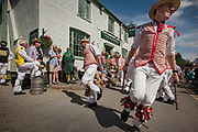 Thaxted Morris Weekend 3-4 June 2017<br /> A meeting of member clubs of the Morris Ring celebrating the 90th anniversary of the founding of the Thaxted Morris Dancing side or team in Thaxted, North West Essex, England UK. <br /> Thaxted Morris Men side, in red and white stripes and Westmister side in black tabbards outside The Maypole pub in Thaxted Essex.<br /> Hundred of Morris dancers from the UK and this year the Silkeborg side from Denmark spend most of Saturday dance outside pubs in nearby villages where much beer is consumed. In the late afternoon all the sides congregate in Thaxted where massed dancing is perfomed along Town Street. As darkness falls across Thaxted the spell binding Abbots Bromley Horn Dance is performed to the sound of a solo violin in the dark.