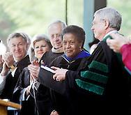 Myrlie Evers-Williams, second from right, receives applause from the stage after giving the commencement address at the University of Mississippi graduation in Oxford, Miss. on Saturday, May 11, 2013.  (AP Photo/Oxford Eagle, Bruce Newman)