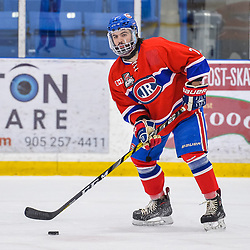 OAKVILLE, ON  - FEB 23,  2018: Ontario Junior Hockey League game between the Oakville Blades and the Toronto Jr. Canadiens, Anthony Paveglio #7 of the Toronto Jr. Canadiens looks to make a play during the first period.<br /> (Photo by Ryan McCullough / OJHL Images)