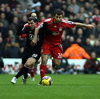 Photo: Mark Stephenson/Sportsbeat Images.<br /> Liverpool v Manchester United. The FA Barclays Premiership. 16/12/2007.Carlos Tevez battles with Javier Mascherano