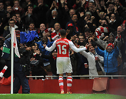 Arsenal's Alex Oxlade-Chamberlain celebrates his goal in front of home fans - Photo mandatory by-line: Dougie Allward/JMP - Mobile: 07966 386802 - 04/11/2014 - SPORT - Football - London - Emirates Stadium - Arsenal v RSC Anderlecht - Champions League - Group D