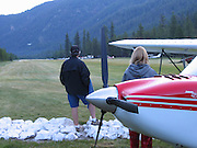 Pilots watching airplane land at Johnson Creek, ID