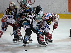 "22.03.2012, Keine Sorgen Eisarena, Linz, AUT, EBEL, EHC Liwest Black Wings Linz vs EC KAC, Playoff, Finale, 1. Spiel, im Bild Philipp Lukas (EHC Liwest Black Wings Linz, #21) and Paul Schellander (EC KAC, #15), during the final match of ""Erste Bank Icehockey League"", first encounter between EHC Liwest Black Wings Linz and EC KAC at Keine Sorgen Eisarena, Linz, Austria on 2012/03/15"