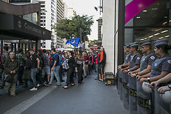 August 2, 2017 - Sao Paulo, Sao Paulo, Brazil - Aug 02, 2017 - Sao Paulo, Sao Paulo, Brazil - Police officers close the entrance to the building of the office of the President of the Republic, in the city of Sao Paulo, during a demonstration by a small group of opponents of the government of Brazilian President MICHEL TEMER, who accompanied on Wednesday afternoon (2) Of televisions installed on the platform, the vote of the complaint of passive corruption against him. (Credit Image: © Marcelo Chello/CJPress via ZUMA Wire)