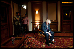 Mayor of London Boris Johnson deep in thought as he waits to be interviewed by the bbc in hotel in Mumbai, Wednesday November 28, 2012. Photo by Andrew Parsons / i-Images