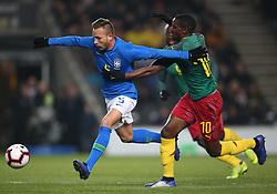Brazil's Arthur (left) and Cameron's Arnaud Djoum battle for the ball