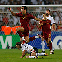 Photo: Glyn Thomas.<br />Germany v Portugal. Third Place Playoff, FIFA World Cup 2006. 08/07/2006.<br /> Portugal's Cristiano Ronaldo (L) leaps over a tackle from Torsten Frings.