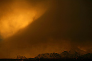 A storm approaches the city of La Paz as it engulfs the snow capped mountain Huayna Potosi at dawn in El Alto, Bolivia, February, 2008.