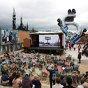Art work by kennardphillipps, various video work, Banksy and Mike Roos. On the first day the show is open only a thousand locals who won free ticket gets an advanced entry to the show.Dismaland, a bemusement park set up by artist Banksy show casing more hand 40 artists. The bemusement park is set in a former lido in Weston Super-Mare.After much secrecy the show opened to a small number of locals from Weston Super-Mare Friday and fully to the public Saturday Aug 22.