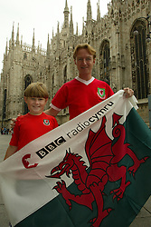 MILAN, ITALY - Friday, September 5, 2003: Wales fans, father and son Tim Hartley and nine-year-old Rees Hartley from Cardiff, in front of the cathedral in Milan. (Pic by David Rawcliffe/Propaganda)