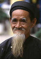 Old man in traditional dress, Hoi An, Vietnam