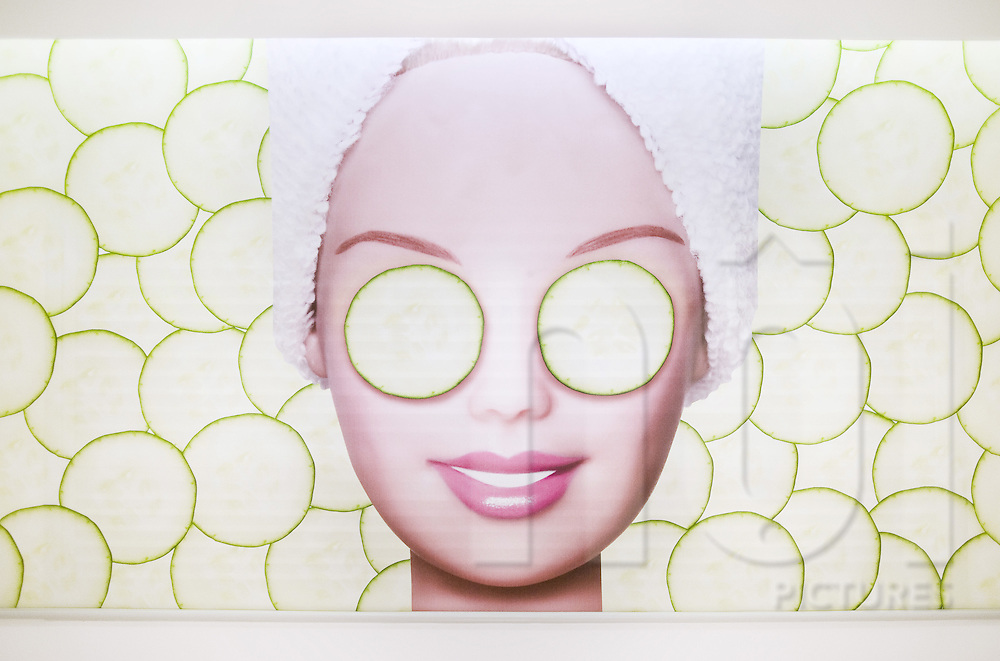 Barbie's face with cucumber slices covering her eyes at Barbie's spa shop in Shanghai, China, Asia