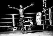 Young Muay Thai fighter celebrates a win during a tournament at Lumpini Stadium. Muay Thai/Thai Boxing Bangkok Thailand March 2003.©David Dare Parker /AsiaWorks Photography