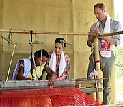 ASSAM (INDIA), April 13, 2016 <br /> <br /> British Prince William (R) and his wife Kate Middleton (C) watch traditional weaving skill during their visit to the Kaziranga National Park in Assam, northeastern state of India, on April 13, 2016. British Prince William and his wife Kate Middleton on Wednesday got a taste of India's wildlife by visiting the Kaziranga National Park in the northeastern state of Assam, home to two-thirds of the world's Indian one-horned rhinos. <br /> ©Exclusivepix Media