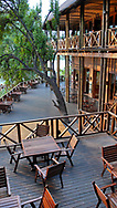 Chobe Marina Lodge, a unique and upscale lodge, is located on the Chobe River, Botswana. Many visitors are attracted to this area for its game drives, safaris, and excursions to the nearby Victoria Falls.