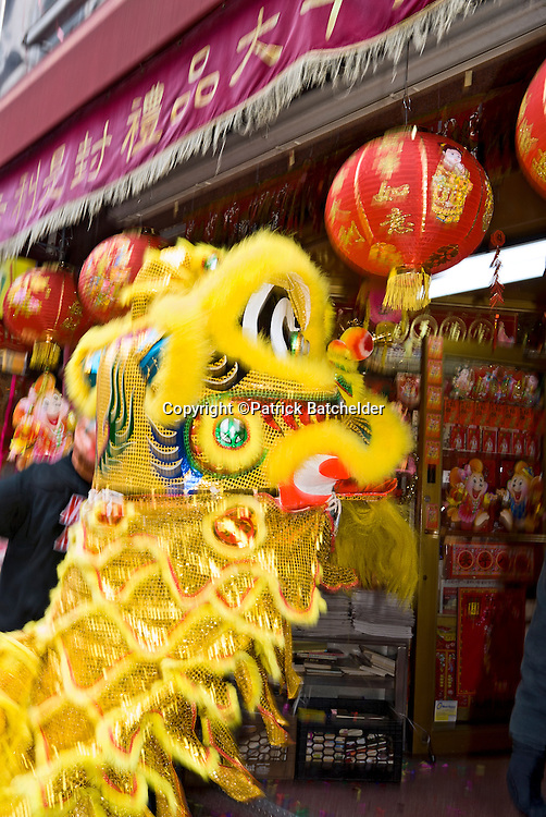The Chinese New Year is celebrated with lion and dragon dancing in Manhattan's Chinatown neighborhood, New York City.