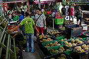Workers open durian fruits for throngs of customers at Durian Kaki, a roadside fruit stall owned by Tan Eow Chong and his family in Bayan Lepas, Pulau Pinang, Malaysia on Sunday, June 16th, 2019. Tan Eow Chong is an award-winning durian farmer famed for his Musang King variety, and last year exported 1000 tons of the fruit to China from his family-run durian empire, expanding from an 80 acre farm to 1000 acres.  Photo by Suzanne Lee/PANOS for Los Angeles Times