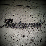 Restaurant sign on a wall