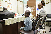 Junior Karampire, 5, who suffers from recurring ear infections, and his mother Kadidiatou Sy, 27, meet with an ENT specialist at the Koumassi General Hospital in Abidjan, Cote d'Ivoire on Friday July 19, 2013.