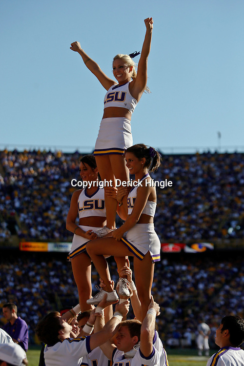 Oct 2, 2010; Baton Rouge, LA, USA; LSU Tigers cheerleaders perform during the second half of a game between the LSU Tigers and the Tennessee Volunteers at Tiger Stadium. LSU defeated Tennessee 16-14.  Mandatory Credit: Derick E. Hingle