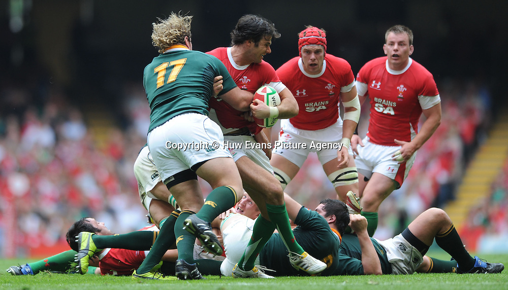05.06.10 - Wales v South Africa - Principality Building Society Summer Test -<br /> Mike Phillips of Wales is tackled by Jannie du Plessis of South Africa.<br /> &copy;Huw Evans Picture Agency