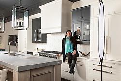 Jennifer Gilmer in her showroom Ad for Gramaco Stone
