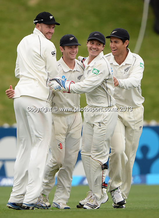 Kane Williamson and team mates celebrate the dismissal of Kirk Edwards on Day 3 of the 2nd cricket test match of the ANZ Test Series. New Zealand Black Caps v West Indies at The Basin Reserve in Wellington. Friday 13 December 2013. Mandatory Photo Credit: Andrew Cornaga www.Photosport.co.nz