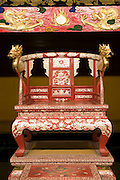 Photo shows  the King's throne in the Usasuka room inside the main Seiden hall of Shuri-jo Castle in Naha, Okinawa Prefecture, Japan, on June 24, 2012. The seat was reproduced from records of the one used by King Sho Shin, who ruled from 1477 to 1526. Seiden functioned as the central structure of the Ryukyu kingdom for over 500 years and was restored in 1992. Photographer: Robert Gilhooly