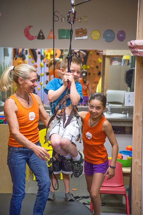 Robyn Erbesfield-Raboutou and her daughter Brooke Raboutou working with children during the dedication of Robyn's ABC For Kids Climbing program at the Momentum Climbing Gym in Sandy Utah.