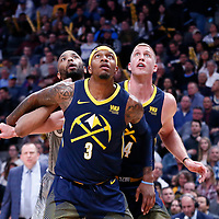 05 April 2018: Minnesota Timberwolves forward Taj Gibson (67) vies for the rebound with Denver Nuggets guard Torrey Craig (3) and Denver Nuggets center Mason Plumlee (24) during the Denver Nuggets 100-96 victory over the Minnesota Timberwolves, at the Pepsi Center, Denver, Colorado, USA.