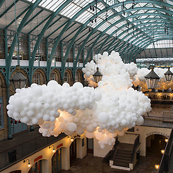 Covent Garden has commissioned artist Charles Pétillon to create a striking, large-scale installation, composed of 100,000 white balloons.The installation stretching 54 metres in length and 12 metres in width, incorporating gentle continuous pulsating white light to symbolise the beating of a heart. The work is titled 'Heartbeat'. will hang in the ceiling space of the South Hall Market Building.Pic Shows the Installation whichh opens to the public on 27th August 15
