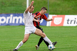 Zeljko Mitrakovic vs Nejc Vidmar at football match between NK Primorje Ajdovscina and NK Triglav Gorenjska of Second Slovenian football league, on May 16, 2010 in Vipava, Slovenia. Primorje placed first in 2.SNL and qualified for  PrvaLiga in season 2010/2011. (Photo by Urban Urbanc / Sportida)