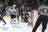 KELOWNA, CANADA - FEBRUARY 18: Deven Dubyk #33 of the Red Deer Rebels defends the net from Cody Chikie #14 of the Kelowna Rockets as the Red Deer Rebels visit the Kelowna Rockets on February 18, 2012 at Prospera Place in Kelowna, British Columbia, Canada (Photo by Marissa Baecker/Shoot the Breeze) *** Local Caption ***