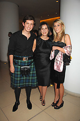 Centre, KIRSTY WARK and her children JAMES CLEMENTS and CAITLIN CLEMENTS at 'Not Another Burns Night' in association with CLIC Sargebt and Children's Hospice Association Scotland held at ST.Martins Lane Hotel, London on 3rd March 2008.<br />