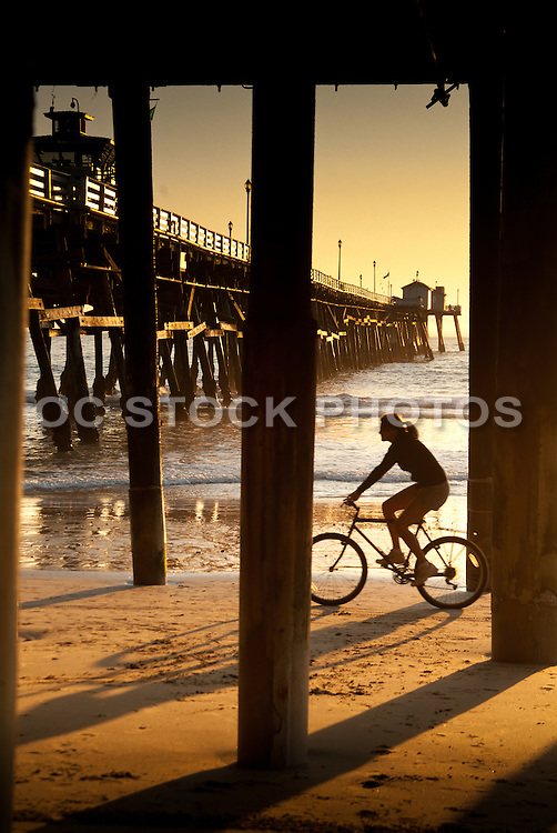 Girl Bike Riding on the Beach by the san Clemente Pier