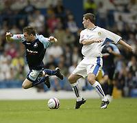 Photo: Aidan Ellis.<br /> Leeds United v Swansea City. Coca Cola League 1. 22/09/2007.<br /> swansea's Paul Anderson loses out to Leeds Frazer Richardson