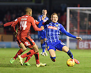 Notts County Midfielder Robert Milsom gets to the ball ahead of Crawley Town Midfielder Lewis Young during the Sky Bet League 2 match between Crawley Town and Notts County at the Checkatrade.com Stadium, Crawley, England on 16 January 2016. Photo by David Charbit.