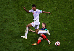 MOSCOW, RUSSIA - Wednesday, July 11, 2018: England's Marcus Rashford is tackled by Croatia's captain Luka Modrić during the FIFA World Cup Russia 2018 Semi-Final match between Croatia and England at the Luzhniki Stadium. (Pic by David Rawcliffe/Propaganda)