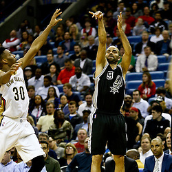 Mar 3, 2016; New Orleans, LA, USA; San Antonio Spurs guard Tony Parker (9) shoots over New Orleans Pelicans guard Norris Cole (30) during the second half of a game at the Smoothie King Center. The Spurs defeated the Pelicans 94-86. Mandatory Credit: Derick E. Hingle-USA TODAY Sports
