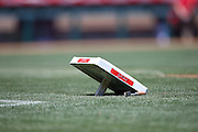 ANAHEIM, CA - MAY 4:  The first base bag lies on the grass before the Los Angeles Angels of Anaheim game against the Texas Rangers at Angel Stadium on Sunday, May 4, 2014 in Anaheim, California. The Rangers won the game 14-3. (Photo by Paul Spinelli/MLB Photos via Getty Images)