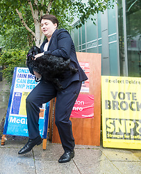 Scottish Conservative & Unionist Party leader, Ruth Davidson, casts her vote in the 2017 General Election along with her partner Jen Wilson and her dog Winston.