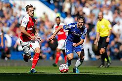 Aaron Ramsey of Arsenal and Cesar Azpilicueta of Chelsea in action - Mandatory byline: Rogan Thomson/JMP - 07966 386802 - 19/09/2015 - FOOTBALL - Stamford Bridge Stadium - London, England - Chelsea v Arsenal - Barclays Premier League.