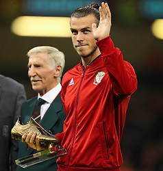 October 11, 2018 - Cardiff City, Walles, United Kingdom - Cardiff, Wales October 11, ..Gareth Bale of Wales receives a Golden boot during Exhibition Match between Wales and Spain at Principality stadium, Cardiff City, on 11 Oct  2018. (Credit Image: © Action Foto Sport/NurPhoto via ZUMA Press)