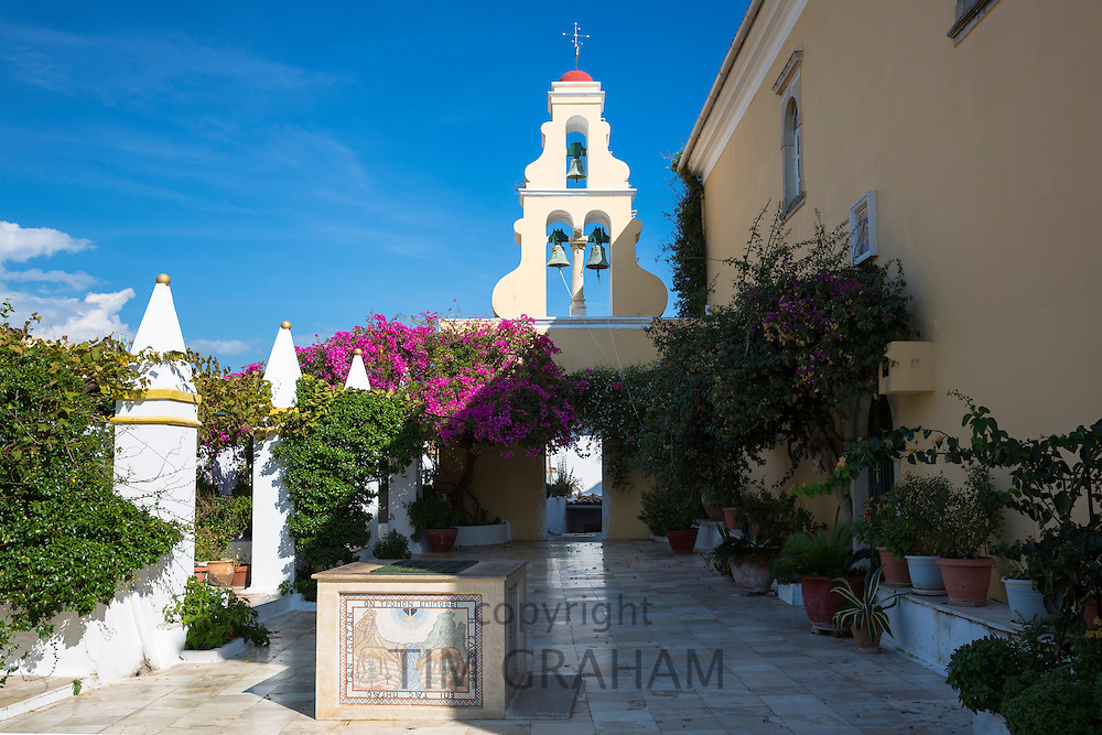 Paleokastritsa Monastery, 13th Century with belltower portico and bougainvillea in courtyard in Corfu, , Greece