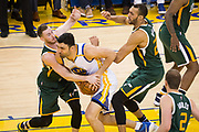 Golden State Warriors center Zaza Pachulia (27) takes the ball to the basket against Utah Jazz forward Gordon Hayward (20) during Game 1 of the Western Conference Semifinals at Oracle Arena in Oakland, Calif., on May 2, 2017. (Stan Olszewski/Special to S.F. Examiner)