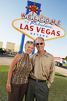 Couple in front of Welcome to Las Vegas sign portrait